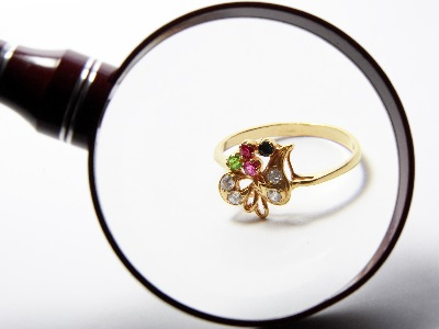 inspecting jewelry under magnification